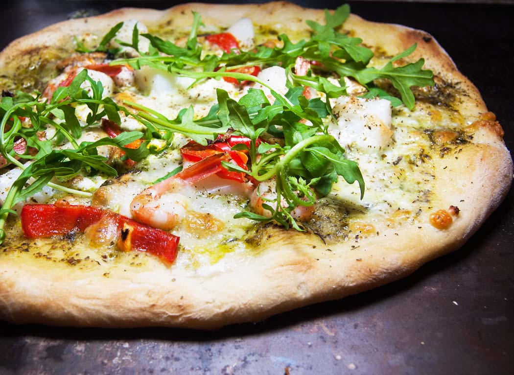 Seafood pizza with basil sauce